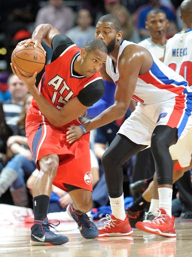 Hawks' Al Horford looks for room around the Pistons'