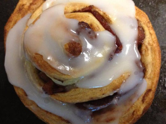 Pepper's Grille is taking a walk on the culinary wild side with their menu featuring all-American favorites, like this maple-bacon wrapped cinnamon bun with cream cheese icing. The eatery opens Tuesday at Central Market.  (Photo courtesy of Pepper's Grille)