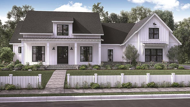 A wide, welcoming porch and central dormer add farmhouse charm to the exterior.