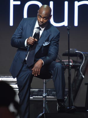 Inside the Diamond Ball, Dave Chappelle cracked jokes and took to the stage with the evening's auctioneer.