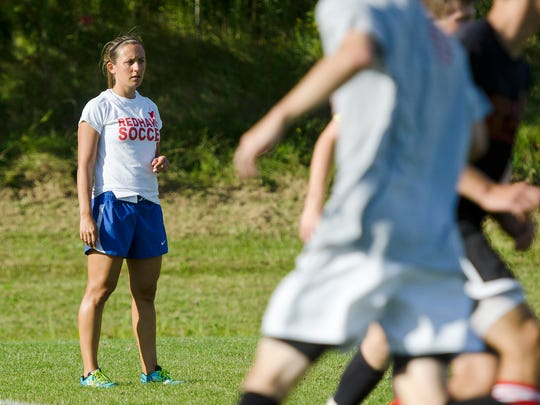 Champlain Valley boys soccer coach Katie Mack, left, directs a drill during a preseason practice in Hinesburg last week. Mack is in her first season at CVU.