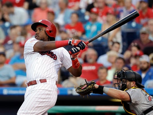 Philadelphia Phillies' Maikel Franco, left, follows through after hitting a two-run home run off Pittsburgh Pirates starting pitcher Ivan Nova during the third inning of a baseball game, Monday, July 3, 2017, in Philadelphia. At right is Pittsburgh Pirates catcher Francisco Cervelli. (AP Photo/Matt Slocum)
