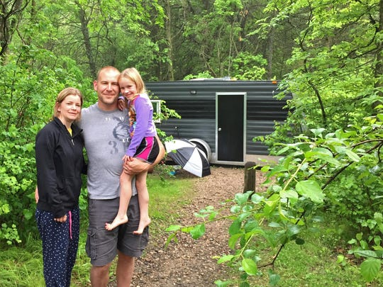 Rachelle and Jason Mathwig of Hutchinson enjoyed their campsite at Sibley State Park with daughter Brynn while their 1-year-old slept inside the fish house that doubles as a camper. Starting in May, all Minnesota state park and recreation area campsites will be reservable. Some had been set aside for walk-in campers.