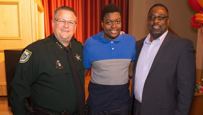 Brevard County Manager Stockton Whitten, right, will be on the local March of Dimes executive leadership team this year. He is pictured with his 16-year-old son, Alden, and Brevard County Sheriff Wayne Ivey.