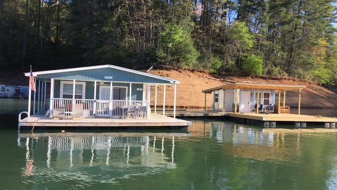 Houseboats like these on Fontana Lake will be allowed to remain following passage of legislation in Washington.