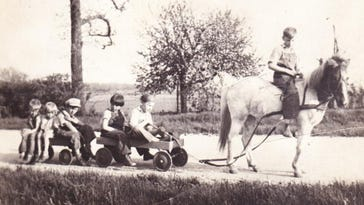 The photo is of Charles (on the family pony, Jerry) along with his siblings and cousins. The picture was taken in 1931 by his mother, Marjorie Foote.