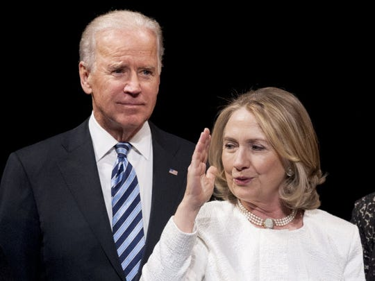 In this April 2, 2013, file photo, Vice President Biden and Hillary Clinton appear onstage at the Kennedy Center for the Performing Arts in Washington.
