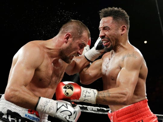 Andre Ward, right, and Sergey Kovalev exchange punches