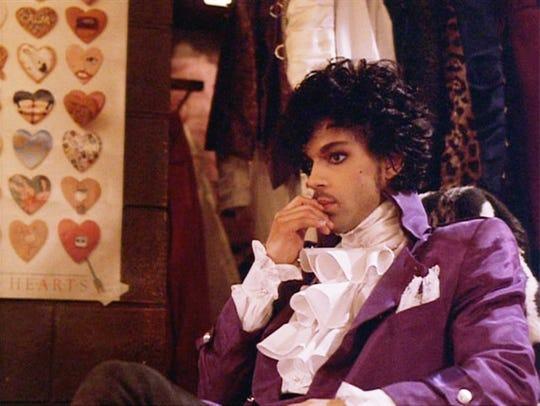 "Prince stars in the 1984 movie ""Purple Rain."""