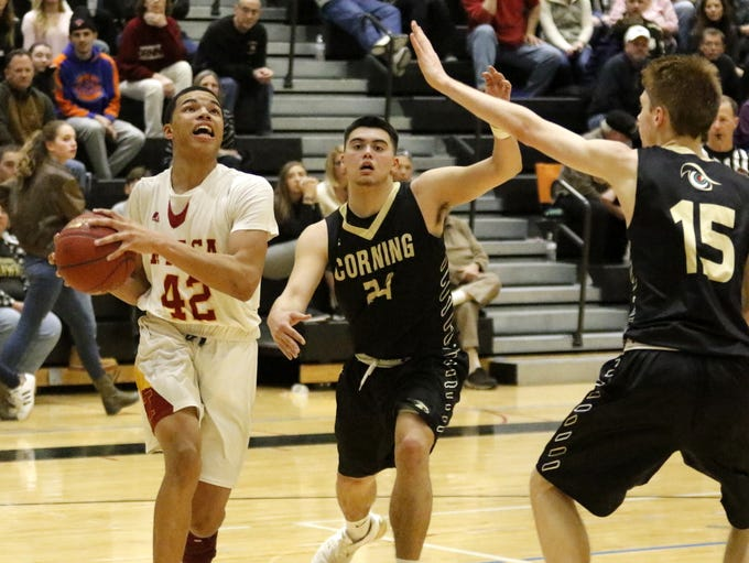 Action from Ithaca's 65-56 win over Corning in the