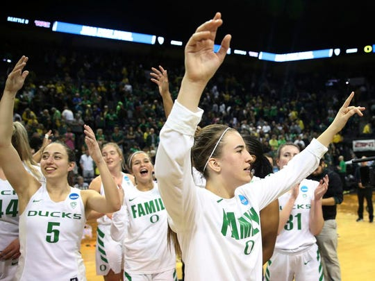Oregon's Maite Cazorla, Anneli Maley, Lexi Bando, Sabrina Ionescu and Aina Ayuso, from left, celebrate the team's victory in a first-round game against Seattle in the NCAA women's college basketball tournament in Eugene, Ore., Friday, March 16, 2018. (AP Photo/Chris Pietsch)