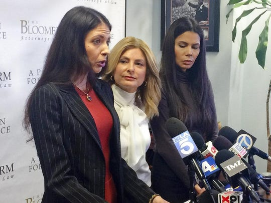 Former model Faviola Dadis, left, reads from a statement at a news conference with her attorney, Lisa Bloom, center, in Los Angeles Monday, March 19, 2018. Dadis, an aspiring actress says she was 17 when actor Steven Seagal sexually assaulted her during a supposed casting session in 2002. At right, Regina Simons who has also accused Seagal of sexual misconduct.