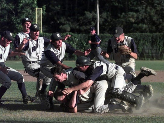 Nicolet players dogpile after winning the 1998 state