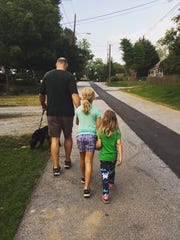 My husband, daughters and dog on a recent evening stroll.