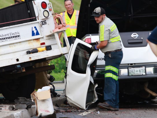 First responders work a fatal multiple vehicle accident