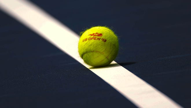 A general view of a tennis ball on a line before a match