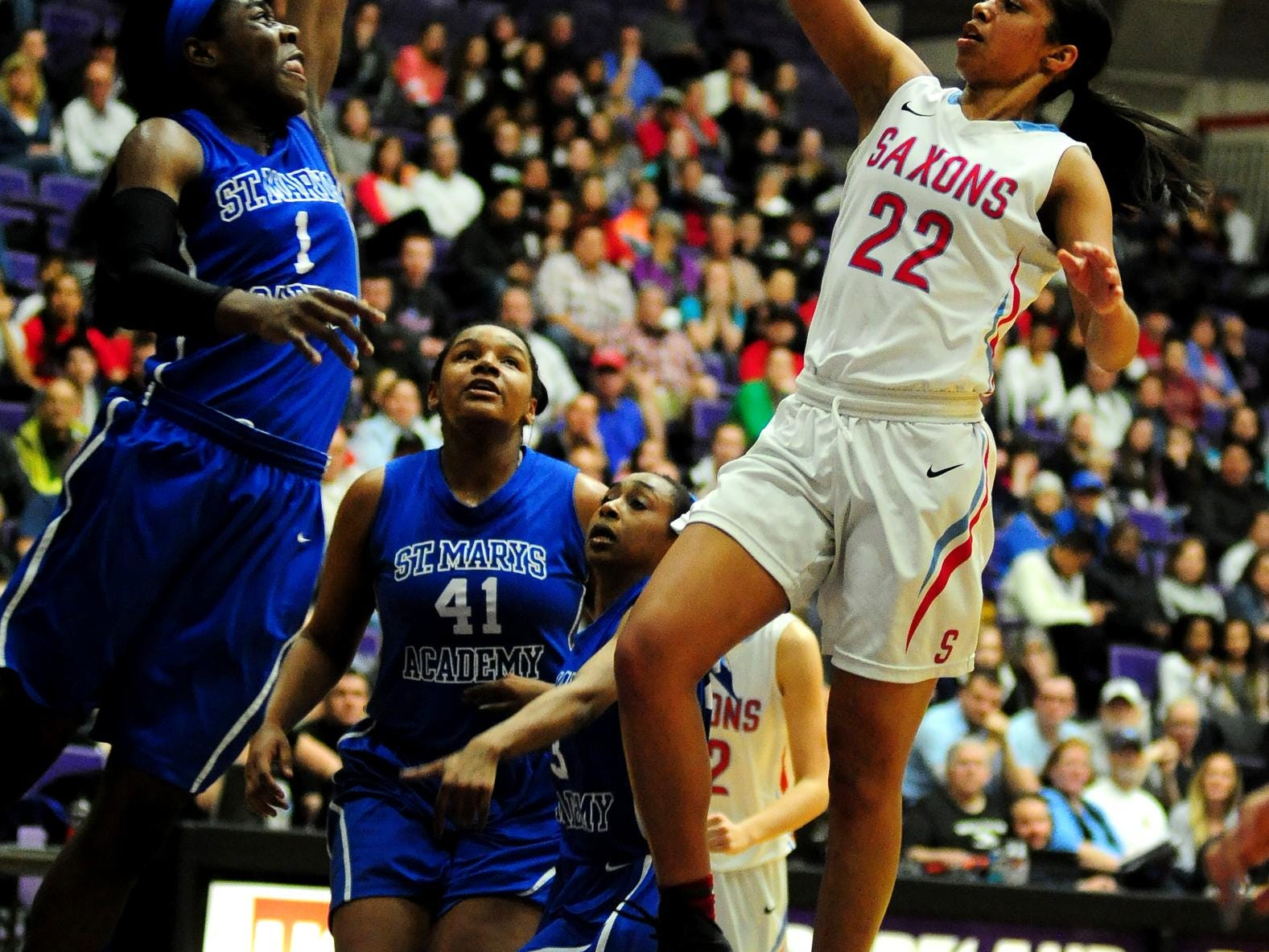 South Salem guard Evina Westbrook shoots a floater of St. Mary's wing Bendu Yeaney during the championship game of the OSAA class 6A basketball tournament inside the Chiles Center, on Saturday, March 14, 2015, at the University of Portland.