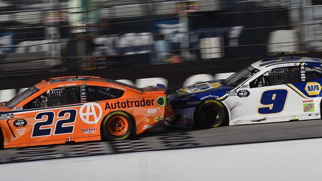 Joey Logano (22) and Chase Elliott (9) are involved in an incident during the Supermarket Heroes 500 at Bristol Motor Speedway on May 31.