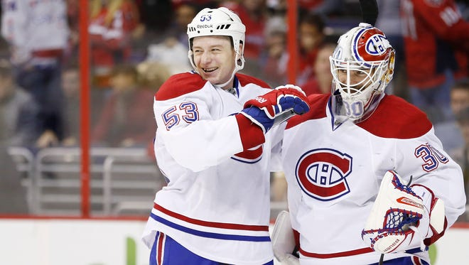 Montreal Canadiens goalie Peter Budaj (30) celebrates with Canadiens center Ryan White (53) after the Canadiens game against the Washington Capitals at Verizon Center.