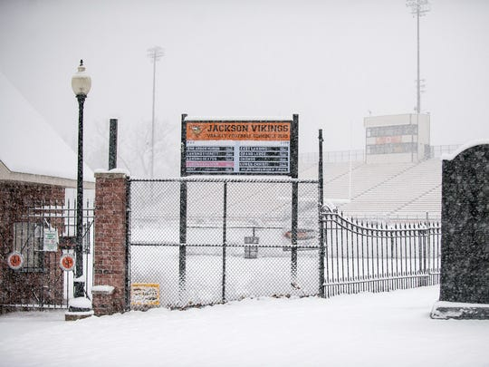 Heavy snow blankets Jackson High School's Withington Stadium causing the semi-final game to be postponed.