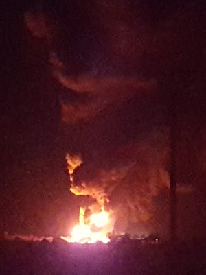 A fire broke out Monday evening at a WPX Energy oil production site near Nageezi. Kendra Pinto, who lives near the site, captured this image after evacuating her home.