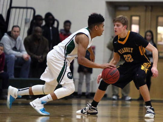 St Joseph's Breein Tyree (left) tries to get past the defense of St. John Vianney on March 4.