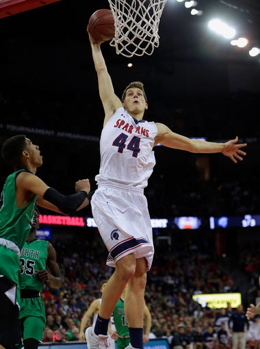 Brookfield East's Patrick Cartier rises for a dunk during the WIAA Division 1 state championship game against Oshkosh North on Saturday, March 17, 2018.