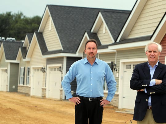 Partners Ralph Meierjohan and T.J. Ackermann at their Hearth Home Communities apartment development in Harrison. They want to build a 40-house subdivision in the East End.