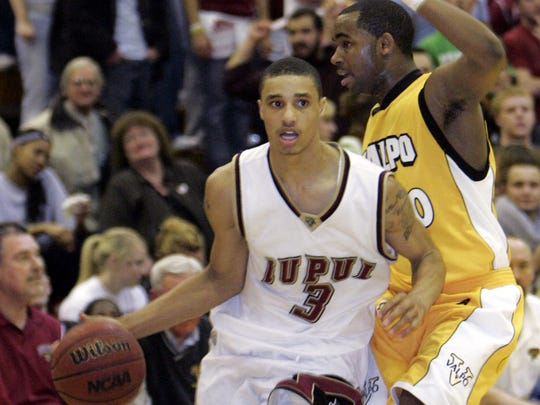 FILE -- IUPUI's George Hill drives against Valparaiso's Brandon McPherson.