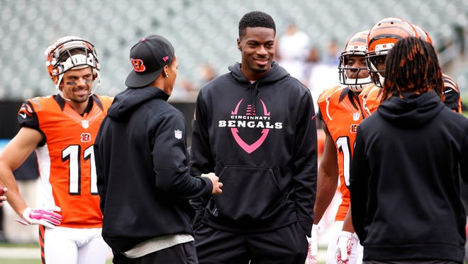 Bengals wide receiver A.J. Green talks to teammates before Sunday's game against Carolina.