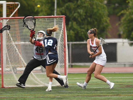 Girls lacrosse state final between Northern Highlands and Immaculate Heart in the North 1, Group 3 tournament. on Thursday May 25, 2017. NH  goalie Victoria Marino (49) following a shot as IHA's Emma Zabransky (12) and NH's Grace Travers crowd the net.