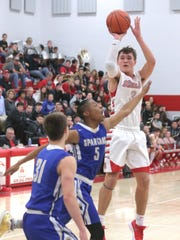 Shelby's Uriah Schwemley shoots in front of the St.
