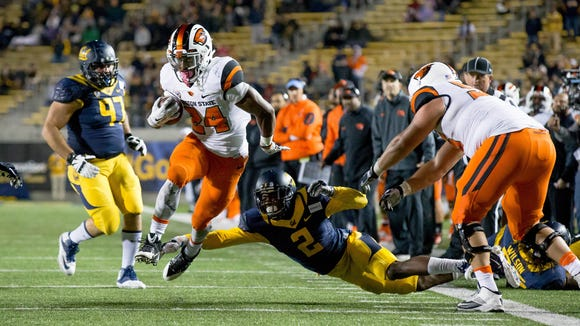 Nov 14, 2015; Berkeley, CA, USA; Oregon State Beavers running back Storm Barrs-Woods (24) carries the ball against California Golden Bears cornerback Darius Allensworth (2) during the third quarter at Memorial Stadium. Mandatory Credit: Kelley L Cox-USA TODAY Sports