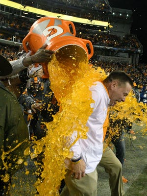 Tennessee Volunteers head coach Butch Jones gets a Gatorade bucket poured on him at the end of the Franklin American Mortgage Music City Bowl at Nissan Stadium in Nashville, Tenn., Friday, Dec. 30, 2016. Tennessee won 38-24.