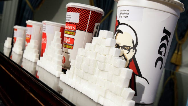 Various size cups and sugar cubes  are displayed at a news conference at New York's City Hall on May 31, 2012.