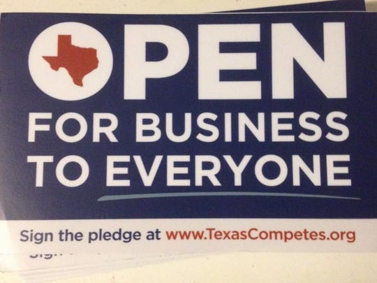 Texas Competes has window stickers for Texas businesses that sign its LGBT support pledge.