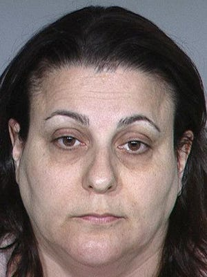 """Murder defendant Gina Drake. Her ex-husband, Aaron Drake, a Ventura police officer who tried to kill himself last month, was """"very involved"""" in the investigation into his former spouse, according to the defense."""
