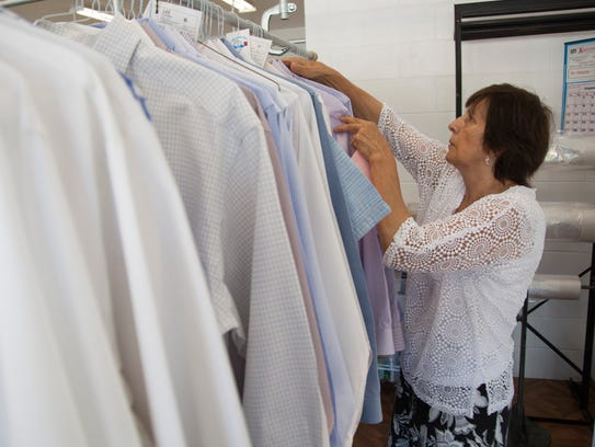 Carmen Lee operates Lee's Cleaners Thursday, Aug. 24,