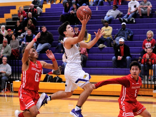 Wylie's Steven Lopez goes to the basket during the 83-34 win against Sweetwater on Tuesday, Feb. 6, 2018 at Bulldog Gym. Lopez scored 15 in the victory.