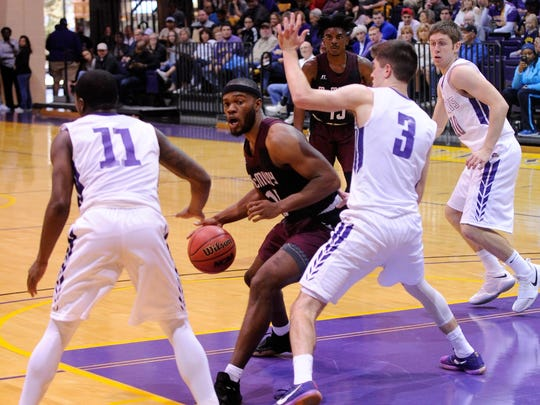 McMurry's LaRandall Scroggins (15) drives into the lane against Hardin-Simmons' Caleb Spoon (3) during the War Hawks' 90-84 loss at the Mabee Complex on Saturday, Feb. 17, 2018.