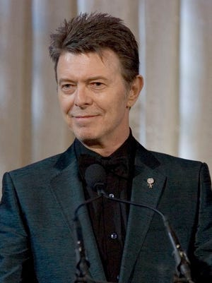 """In this June 5, 2007 file photo, David Bowie attends an awards show in New York.  Bowie wanted his ashes to be scattered in Bali, """"in accordance with the Buddhist rituals"""" and left most of his estate to his widow, the supermodel Iman and his two children, according to his will filed Friday, Jan. 30, 2016."""