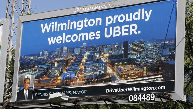 A billboard for the ride-hailing service Uber is shown at West 18th Street and Augustine Road in Wilmington.