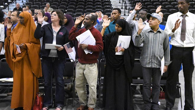 New United States citizens are administrated the Oath of Allegiance during a 2015 naturalization ceremony at River's Edge Convention Center.