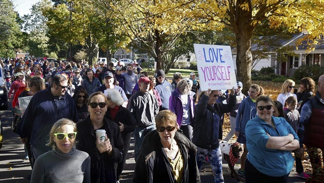 People march in a yoga pants parade in Barrington, R.I., Sunday, Oct. 23, 2016.