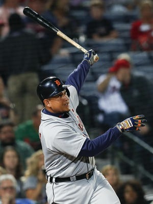 FILE - In this Sept. 30, 2016, file photo, Detroit Tigers' Miguel Cabrera follows through on a solo home run in the fourth inning of a baseball game against the Atlanta Braves in Atlanta. Victor Martinez, Justin Verlander, Cabrera and the rest of the Tigers will have another chance to make a run at the postseason this year. Detroit fell just short of a wild card in 2016, and although there's been some talk of cutting costs, the Tigers haven't started any major rebuilding process. (AP Photo/John Bazemore, File)