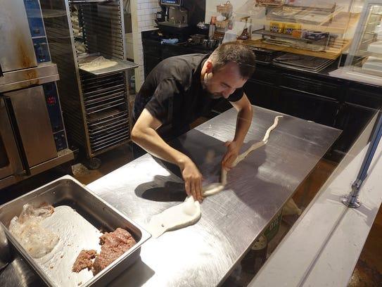Jasenko Osmic prepares burek, a meat-filled Bosnian