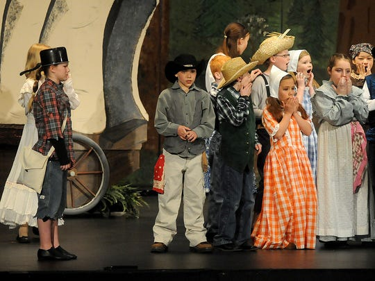 Past Renaissance Youth Opera Theatre performance of Seven Brides for Seven Brothers.