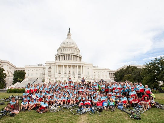 Climate Ride participants pose in front of the U.S.