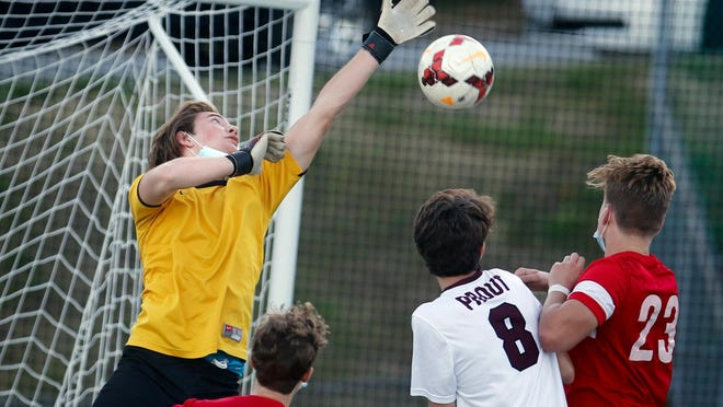 Prout goalie Drew Brouillette leaps to tip a ball from the goal during second-half action  Wednesday afternoon.