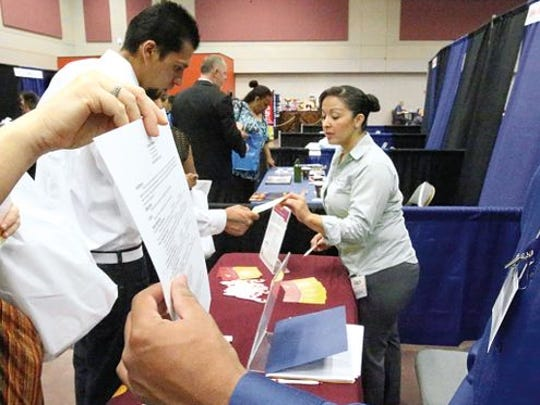 Resumes were taken at El Paso's largest job fair in August at the Downtown convention center. El Paso jobs are projected to grow 1.1 percent in 2016, slightly slower than in 2015, a UTEP economic forecast shows.